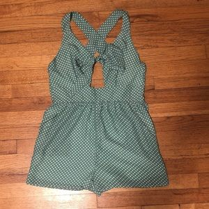 Green with white polka dots romper
